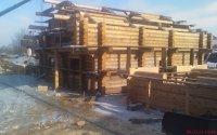 Деревянный дом из оцилиндрованного бревна кедра