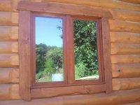 Окно в деревянном доме